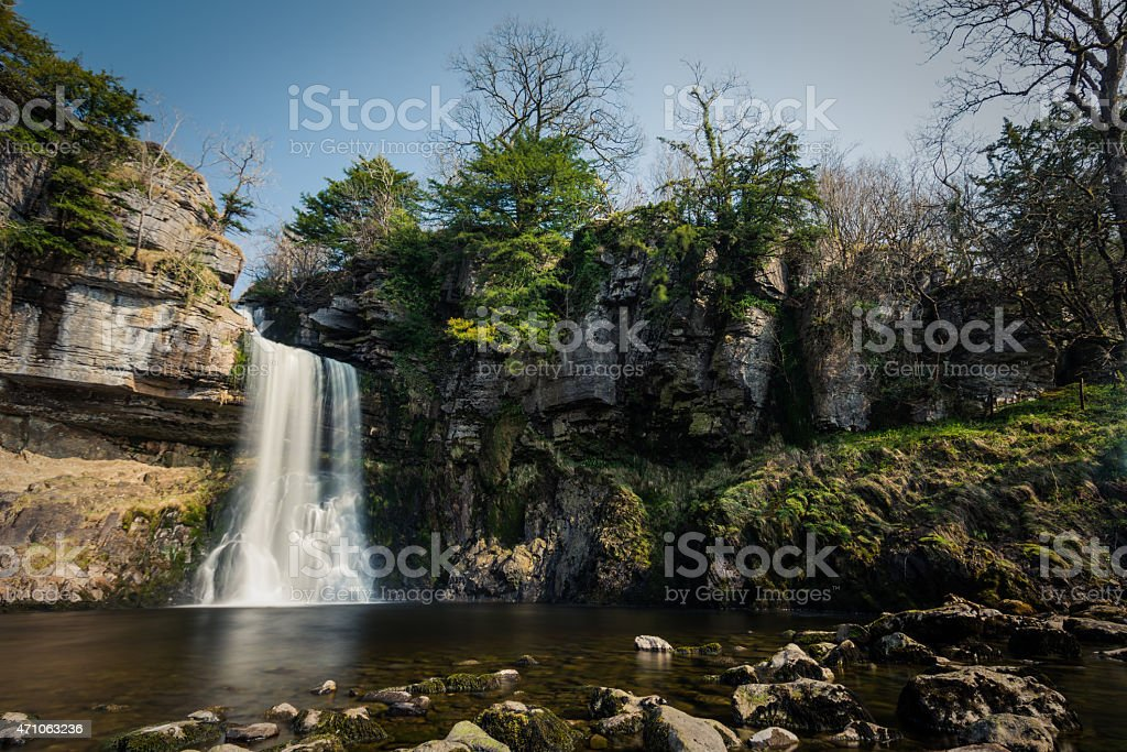 Beautiful Tall Waterfall In The English Yorkshire Dales. stock photo