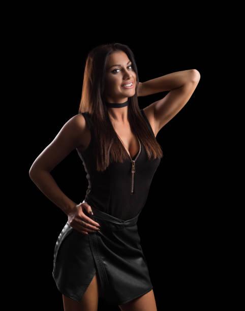beautiful tan female model posing in short  leather skirt - damen rock braun stock-fotos und bilder