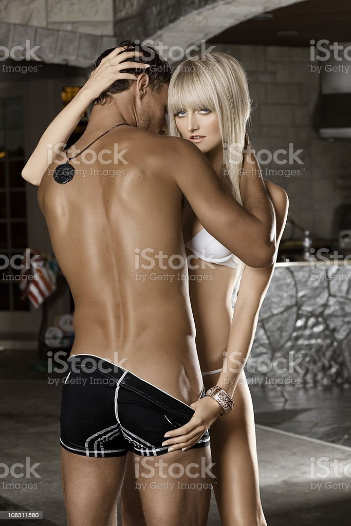 Beautiful Tan Sexy Young Couple in Swimsuits, Embracing royalty-free stock photo