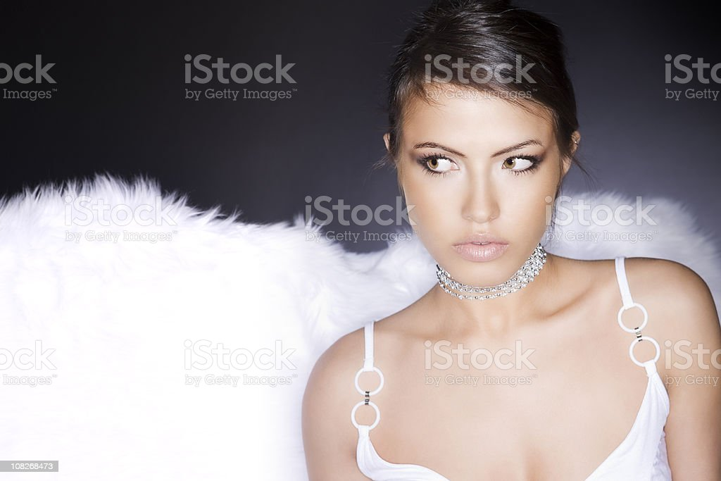 Beautiful Tan Woman in White Lingerie Looking Sideways, Copy Space stock photo