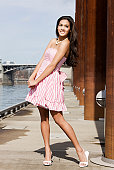 istock Beautiful Tan Young Woman in Pink Striped Dress on Pier 157328449