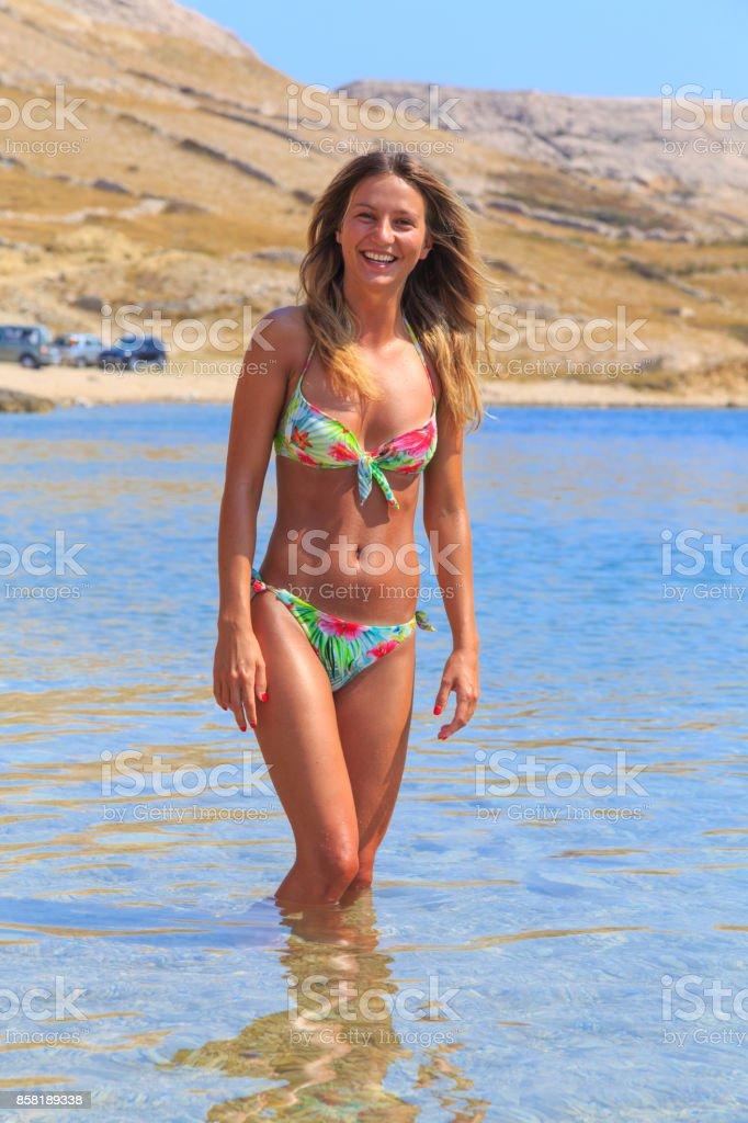 Beautiful Tanned Girl In A Bikini Standing In A Water Royalty Free Stock Photo