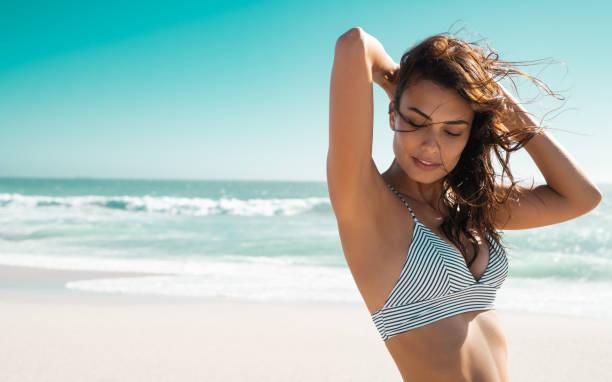 Beautiful tanned woman in bikini stock photo