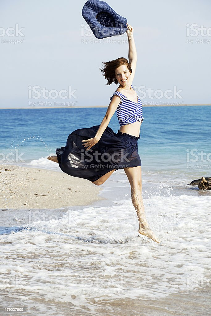 beautiful  tanned woman resting on the beach in summer day royalty-free stock photo