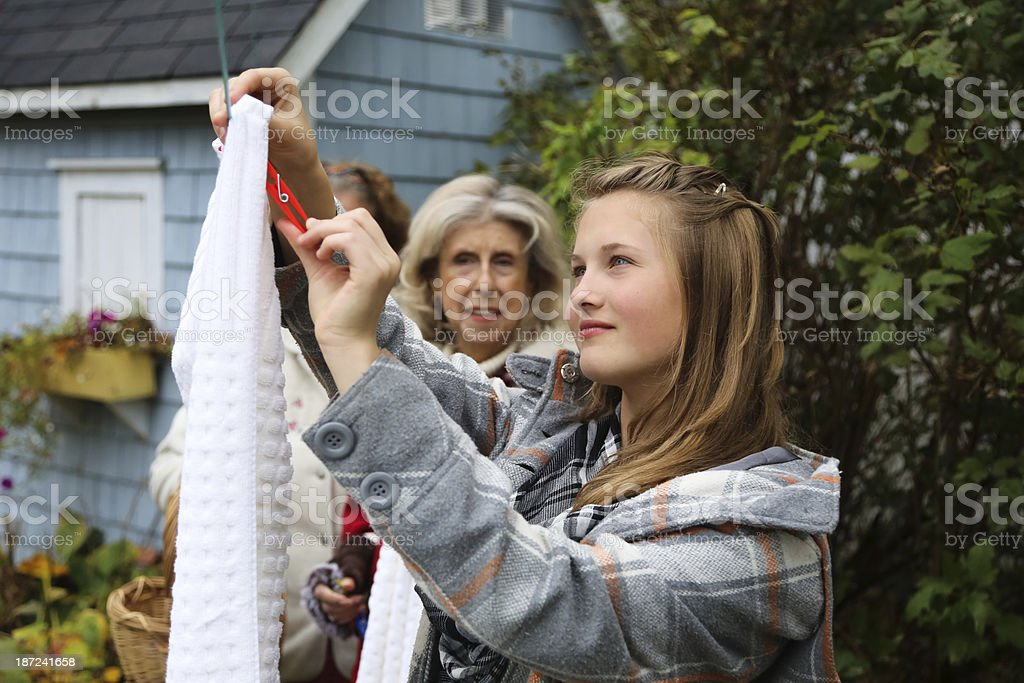 Beautiful Teen and Grandma Hanging Out Laundry royalty-free stock photo