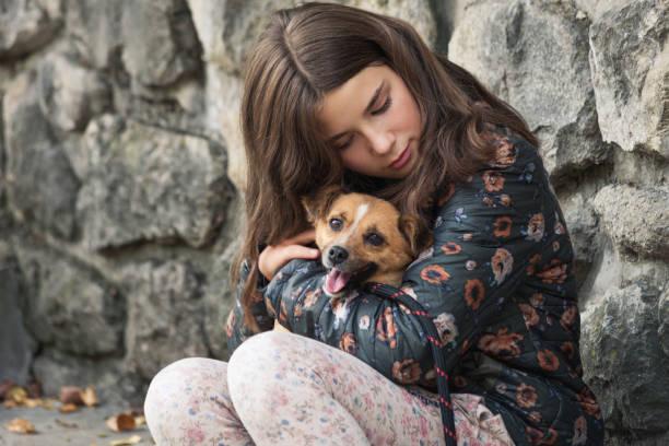 beautiful teen girl hugging her new pet stock photo