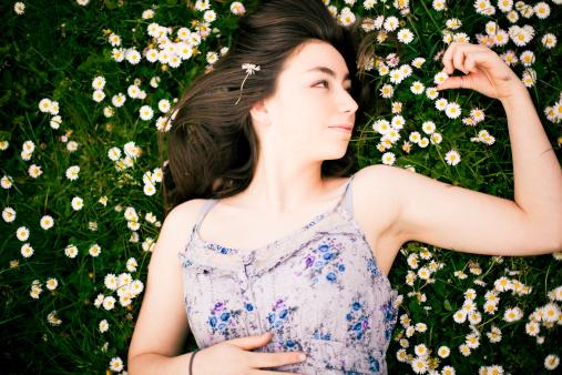 Beautiful Teen Girl Laying Down In A Grass Field Stock ...