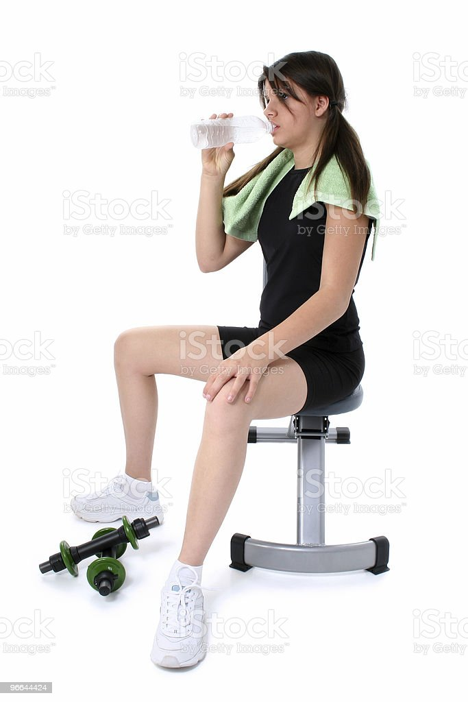 Beautiful Teen Girl Sitting On Workout Bench With Water royalty-free stock photo