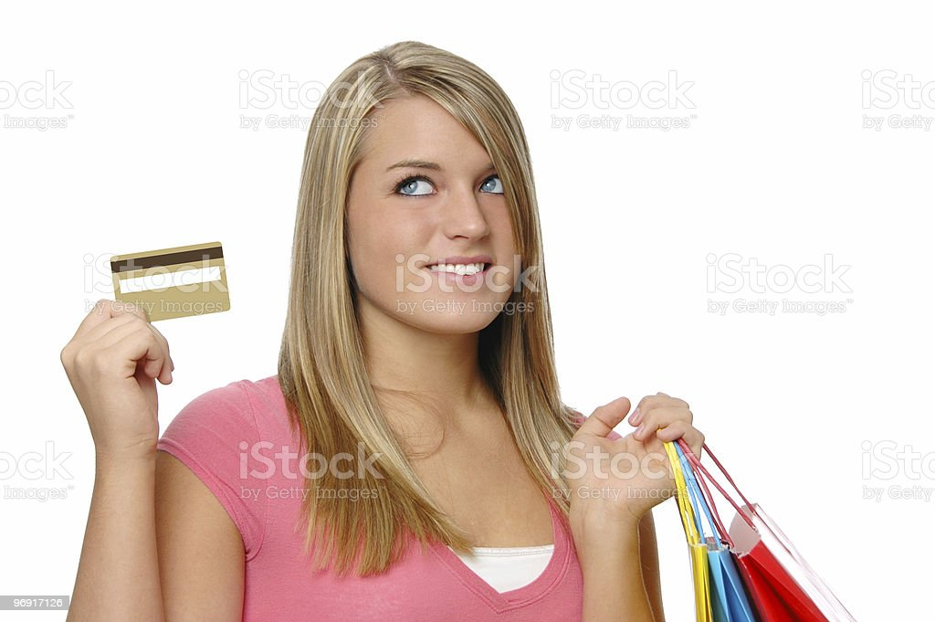 Beautiful teen girl with blank credit card royalty-free stock photo