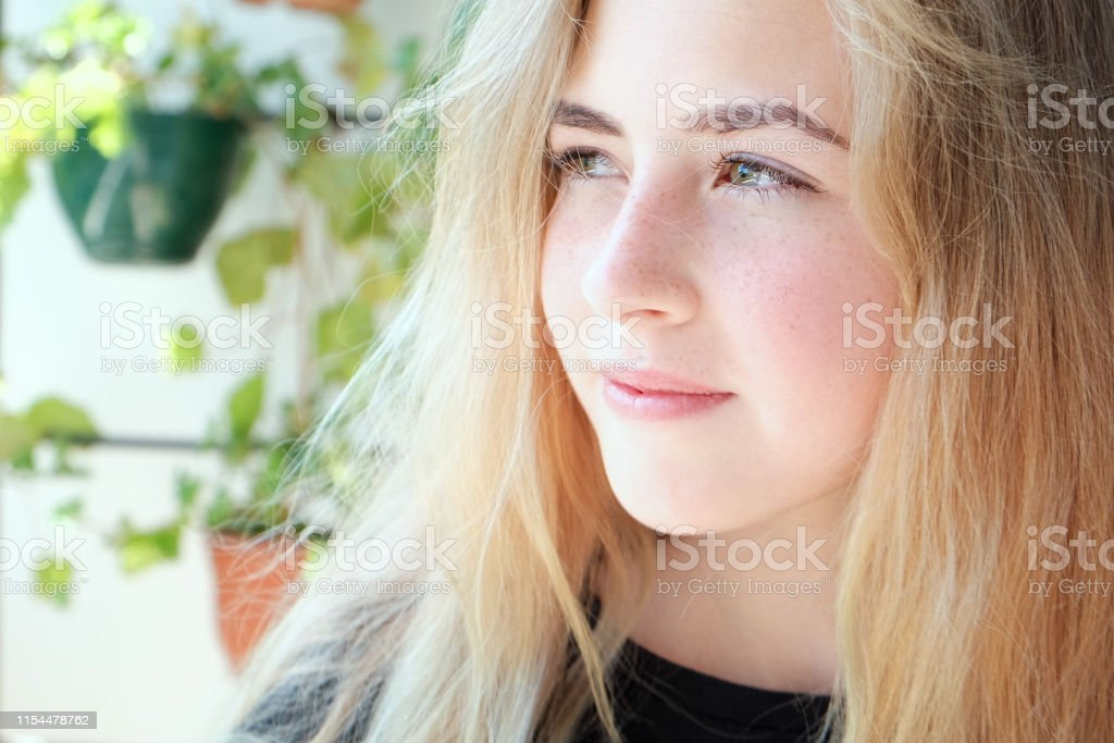 Beautiful Teen Girl With Blond Hair Green Eyes And Freckles Stock