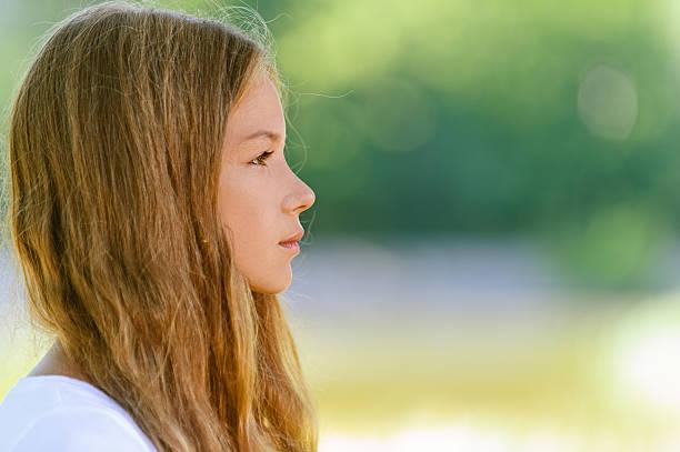 beautiful teenage close up profile stock photo