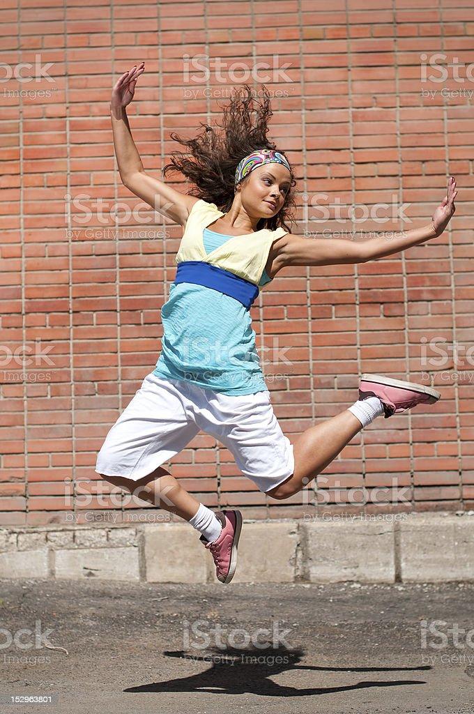 Beautiful teenage girl dancing hip-hop stock photo