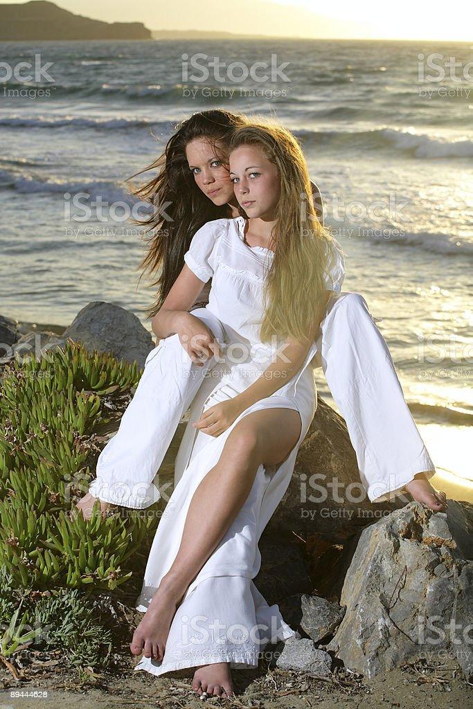 beautiful teenage girls over sunset royalty-free stock photo