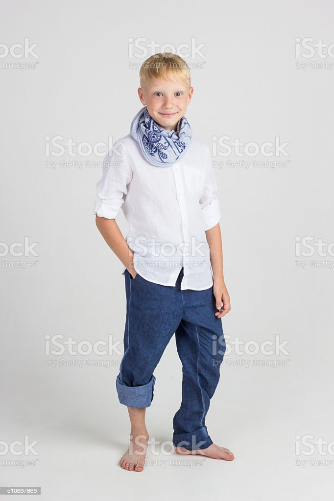 Beautiful teenager boy smiles stock photo