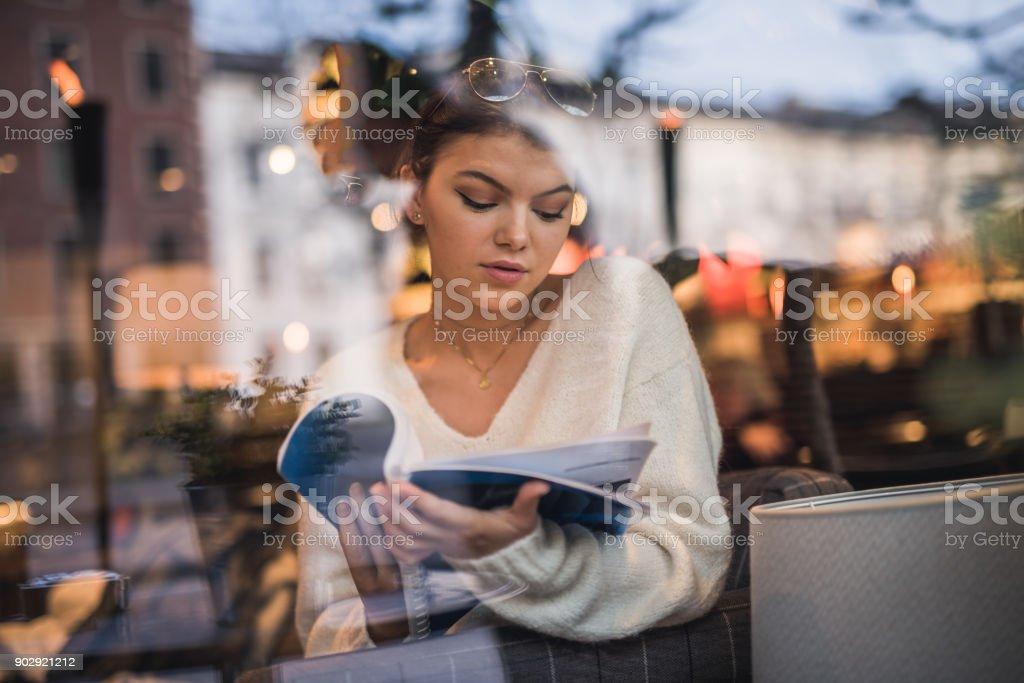 Beautiful teenager girl reading a book. stock photo
