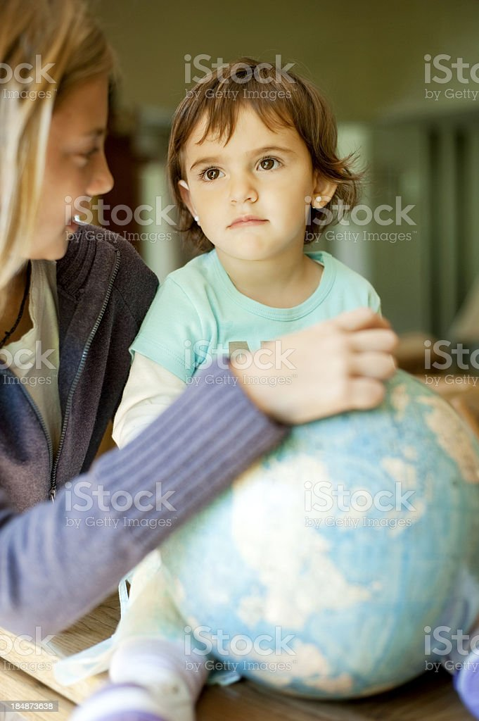 Beautiful teenager pointing the world. royalty-free stock photo