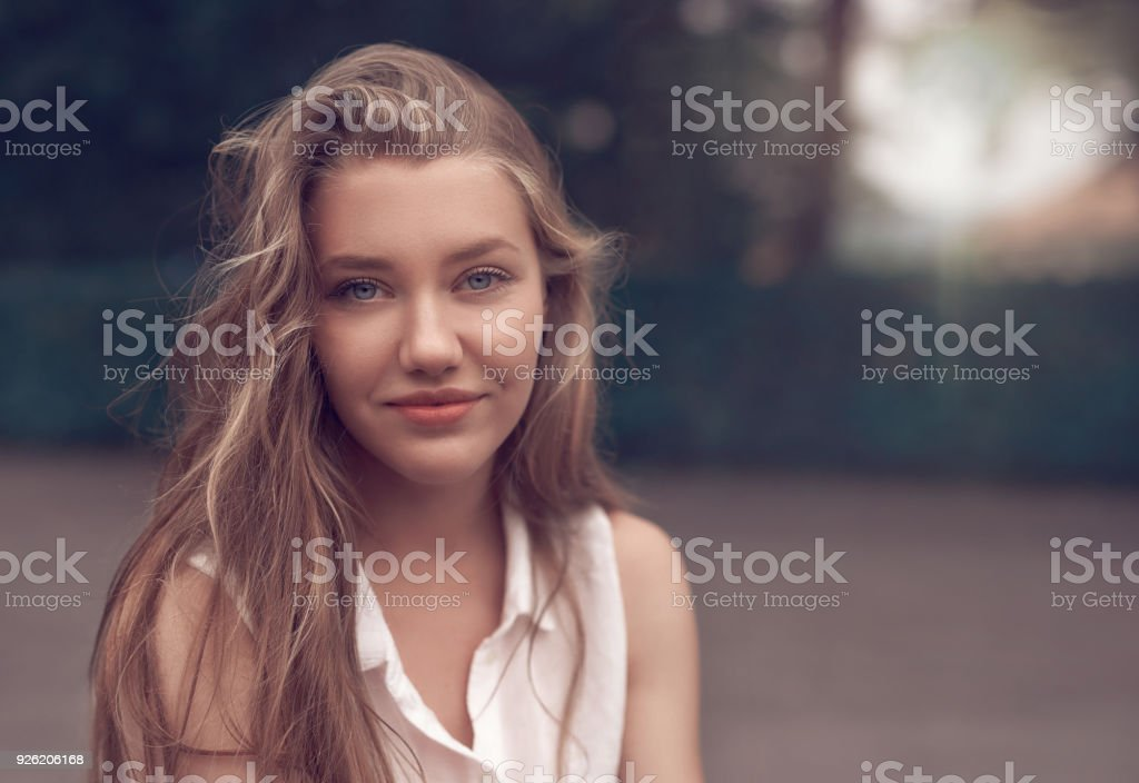 beautiful teenager woman in the park stock photo