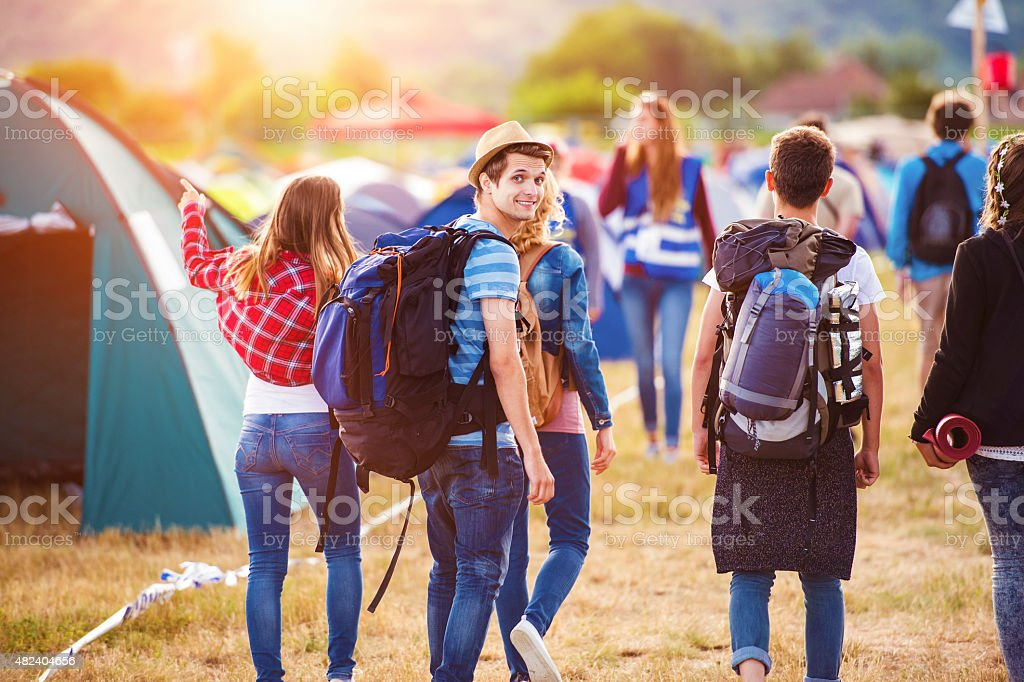 Beautiful teens at summer festival stock photo