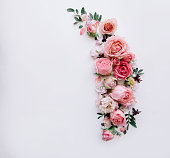 istock Beautiful tender blossoming floral frame of pink roses, eustoma, mattiola, tulips, eucalyptus on the white background, top view, flat lay 1084112770