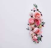 istock Beautiful tender blossoming floral frame of pink roses, eustoma, mattiola, tulips, eucalyptus on the white background, top view, flat lay 1084112804