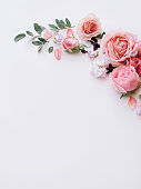 istock Beautiful tender blossoming floral frame of pink roses, eustoma, mattiola, tulips, eucalyptus on the white background, top view, flat lay 1084112832