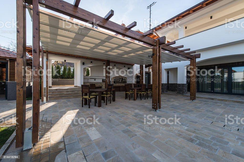 Beautiful terrace lounge with pergola stock photo
