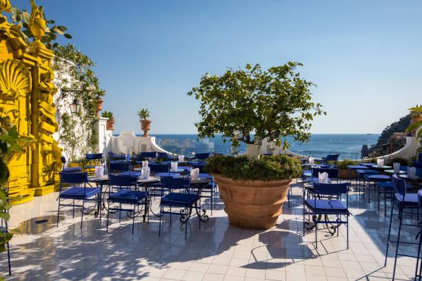 A beautiful terrace overlooking the coastal town of Positano on Amalfi Coast.  Italy stock photo
