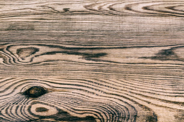 Beautiful texture from old weathered wood with annual rings and knots stock photo