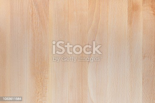 istock Beautiful texture of wooden table in natural color. View from above. Lamas in vertical direction. Space to insert your own text here. 1053611584