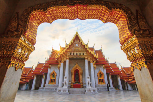 Beautiful Thai temple with sunlight in morning time stock photo