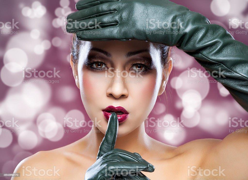 Beautiful Thai woman wearing leather gloves stock photo
