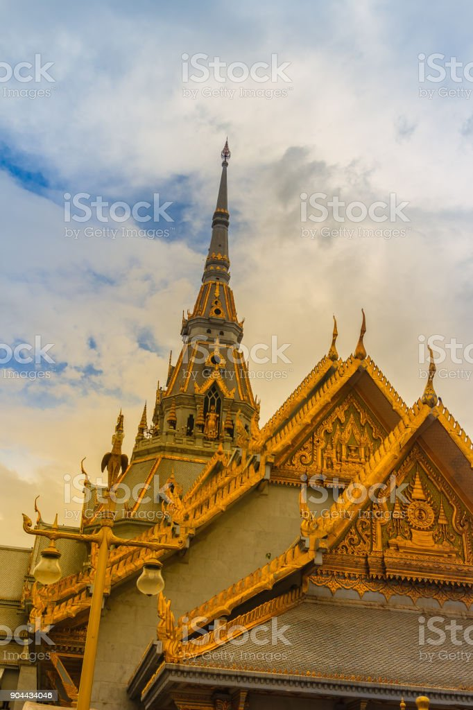 Beautiful Thai's style craving and decoration on the golden gable end at Wat Sothonwararam, a famous public temple in Chachoengsao Province, Thailand. stock photo