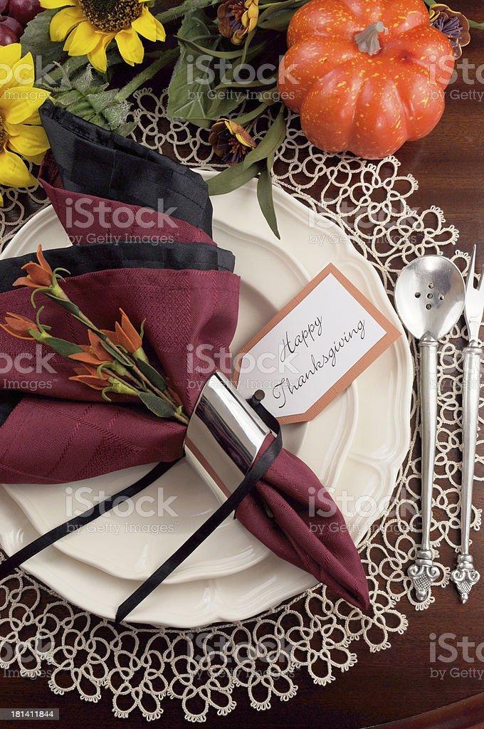 Beautiful Thanksgiving place setting on dark mahogany table royalty-free stock photo