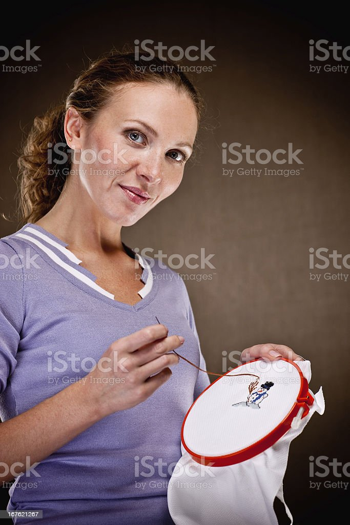 Beautiful Thirty Years Old Woman Making Christmas Embroidery stock photo