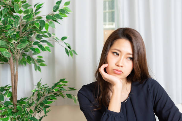 beautiful thoughtful woman stock photo