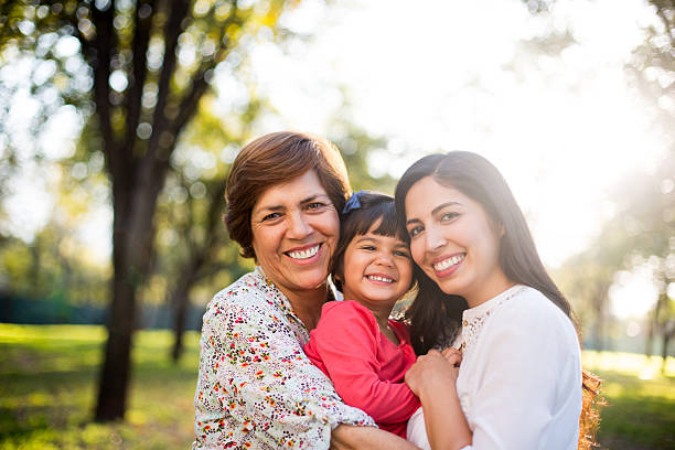 beautiful three generation family - granddaughter and grandmother stock photos and pictures