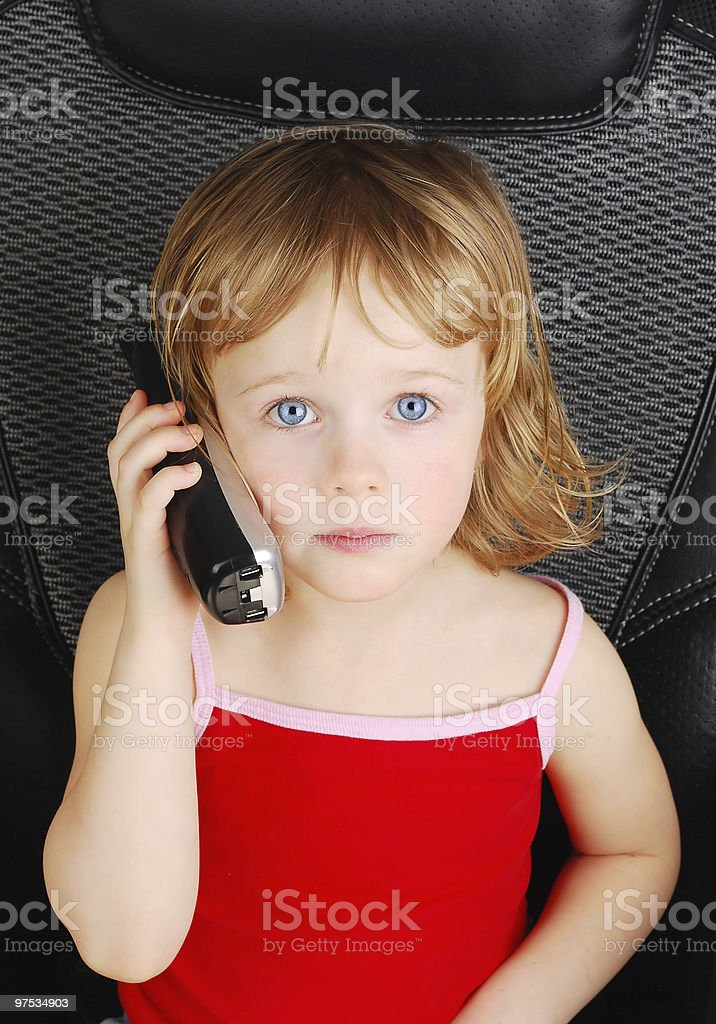 Beautiful three-year-old  girl talking on phone. royalty-free stock photo