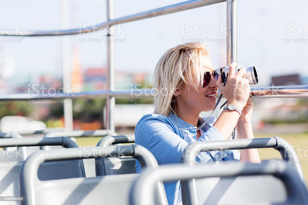 beautiful tourist taking photos of the city stock photo