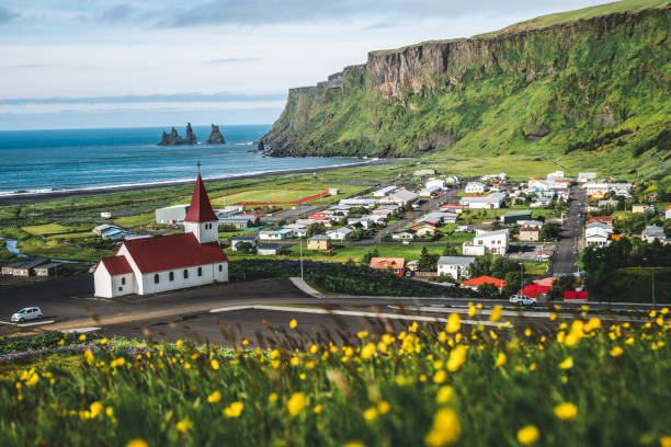 Beautiful town of Vik i Myrdal in Iceland in summer. The village of Vik  is the southernmost village in Iceland on the ring road around 180 km southeast of Reykjavík. stock photo