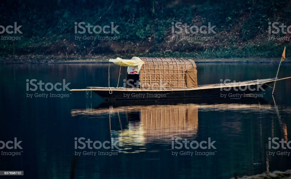Beautiful traditional boat on the river water stock photo