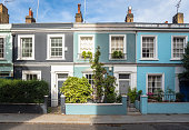 Row of Colourful Old Terraced Houses in the London Neighbourhood of Notting Hill on a Sunny Autumn Day
