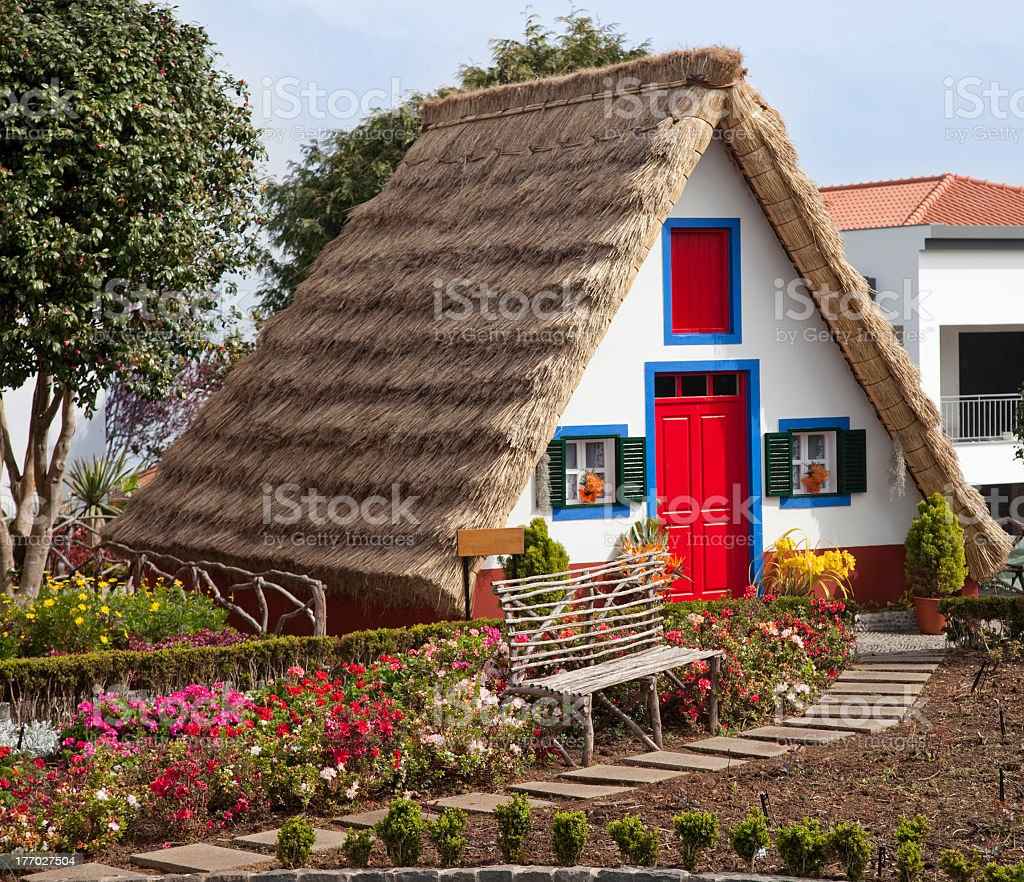 A beautiful traditional cottage in Santana, Portugal stock photo