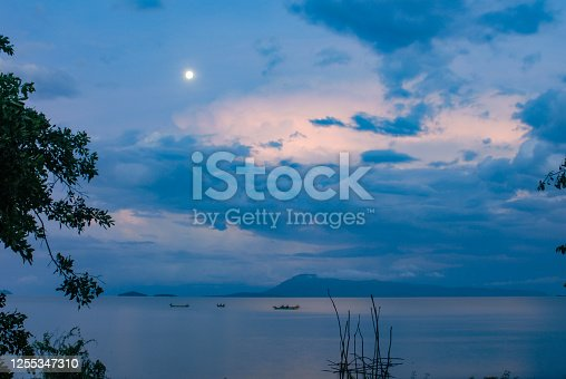 Beautiful Traditional Fishing Boats on an African Lake with dramatic sky Mbita towards Rusinga Island Lake Victoria Nyanza Province Kenya East Africa