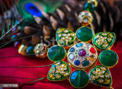 This photo was taken at my home during lock down situation.  This is metal and stone made Traditional Indian jewelry.