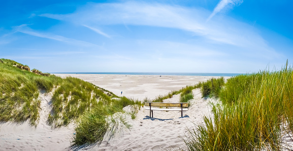 Beautiful tranquil dune landscape and long beach at North Sea