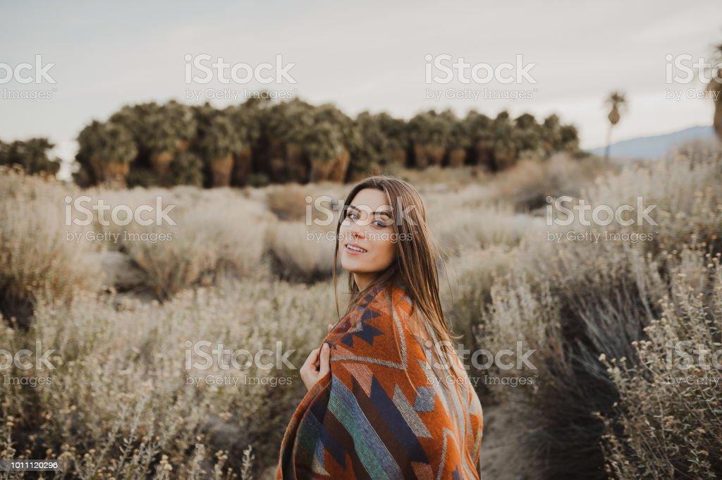 Beautiful traveler girl in gypsy look in desert nature stock photo
