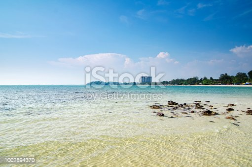 istock Beautiful tropical beach and blue sky background 1002894370