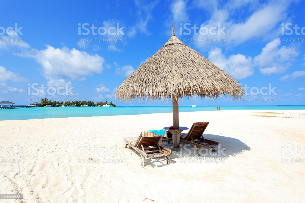 Beautiful tropical beach with deck chair. royalty-free stock photo