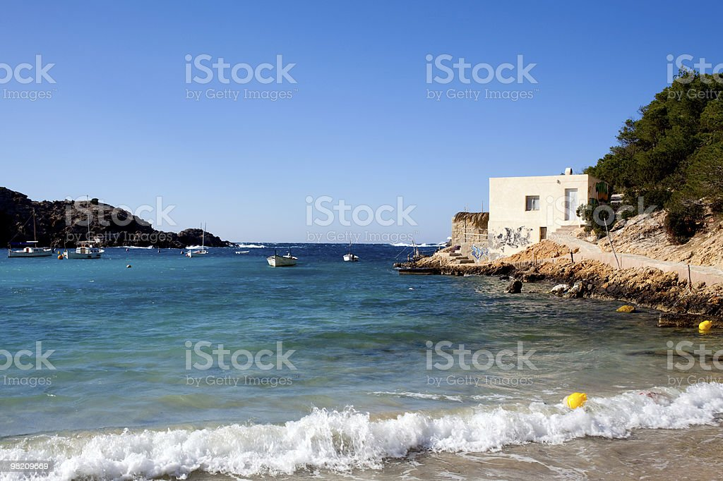 Beautiful tropical beach with small hut royalty-free stock photo