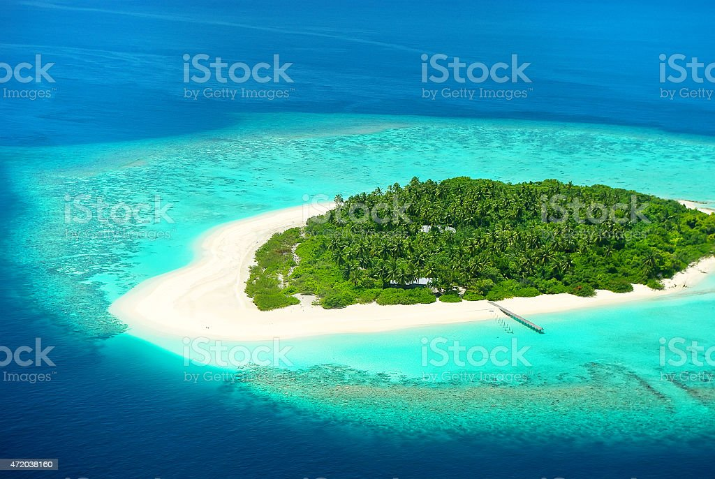 Beautiful tropical island from above. Maldives, Carribean or Sou stock photo